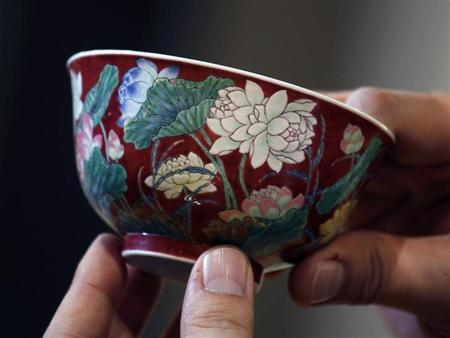 """A magnificent Ruby-Ground Falangcai """"Double-Lotus"""" Bowl Blue Enamel Yuzhi Mark and Period of Kangxi is shown after Hong Kong Chinese ceramics dealer William Chak has bought it for HK$74 million ($9.5 million) at Sotheby's Spring Sales in Hong Kong April 8, 2013. Sotheby's said in a press release the deal set a world auction record for Qing Kangxi porcelain. REUTERS/Bobby Yip"""