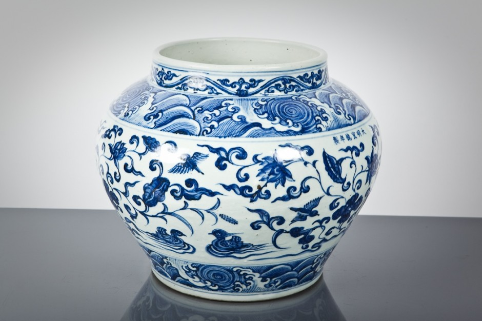 Their description: Lot: 204  |  Estimate: £3000 - £4000 CHINESE BLUE AND WHITE PLANTER decorated with foliate and bird motifs, 30cm high.