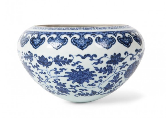Decription: Lot 366 AN UNUSUAL BLUE AND WHITE `ALMS` BOWL POSSIBLY QIANLONG PERIOD the exterior decorated with lotus blooms among stylised scrolling foliage, below a border of ruyi heads to the rim, the cobalt blue generously applied and resulting in a `heaping and piling` effect. Estimate: £2,000 - £4,000