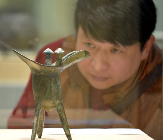 Art spending in China slows in 2014 as collectors seek masterworks at home and abroad.