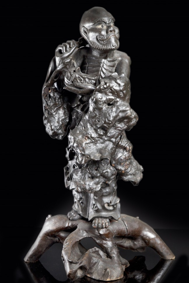 A Large Lacquered Root Wood Figure Of Damo